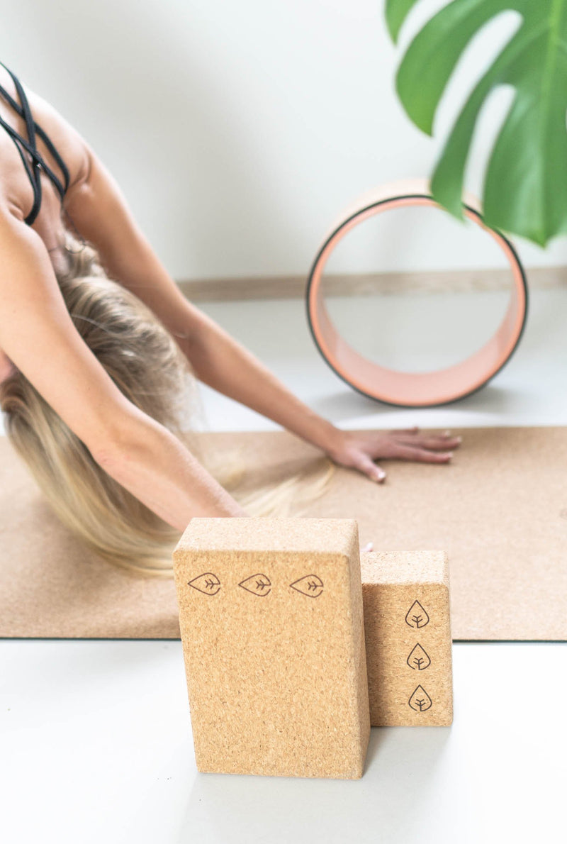best cork yoga mat review why buy a cork yoga mat, benefits of yogamat cork, thick cork mat, the asanas, cork yoga block, yoga wheel, carrying strap for yoga mat how to use cork yoga wheel