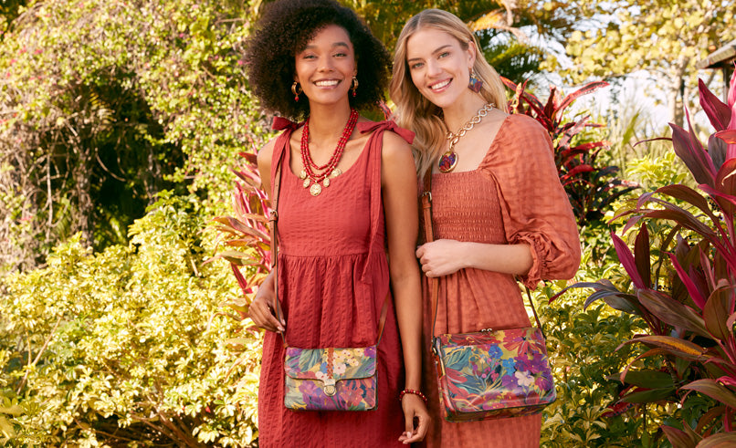 two models wearing leopard print bags
