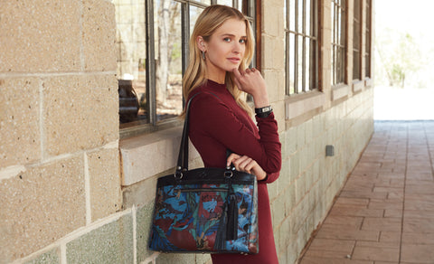 model wearing blue forest print poppy tote