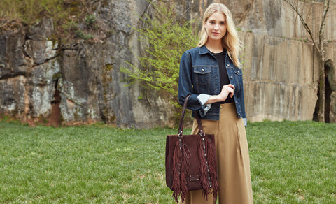 model wearing oil burnished suede vincenza bag