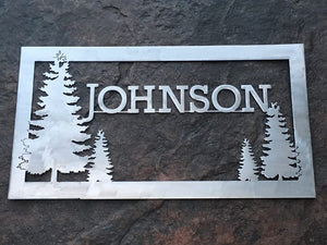 customizable metal sign featuring family name and pine trees