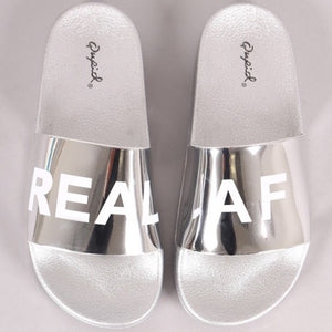 """REAL AF"" Silver Metallic Slides"
