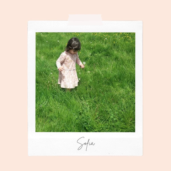 girl collecting flowers in a field