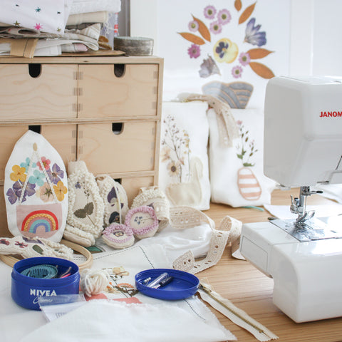 workspace with sewing machine and handmade product samples