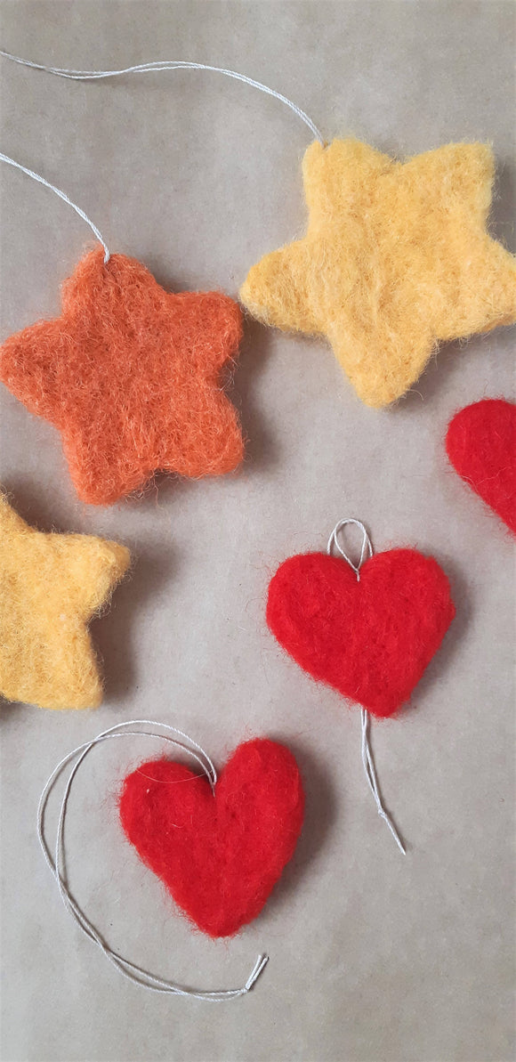 Handmade needle felted Christmas tree decorations heart and star.