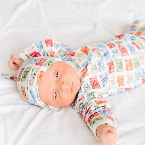 Baby laying down wearing Magnetic Me's My Perfect Selfie print