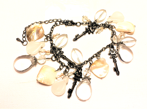 Bohemian style charm bracelet with white & cream accents