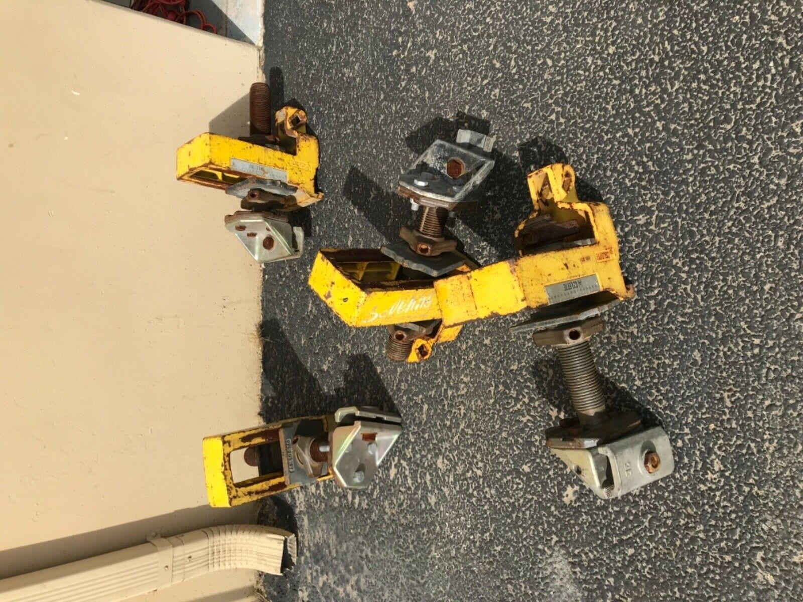 USED SET OF 4 CELETTE SEVENNE ANCHORING  CLAMPS WITH YELLOW SILL CLAMPS AS-IS