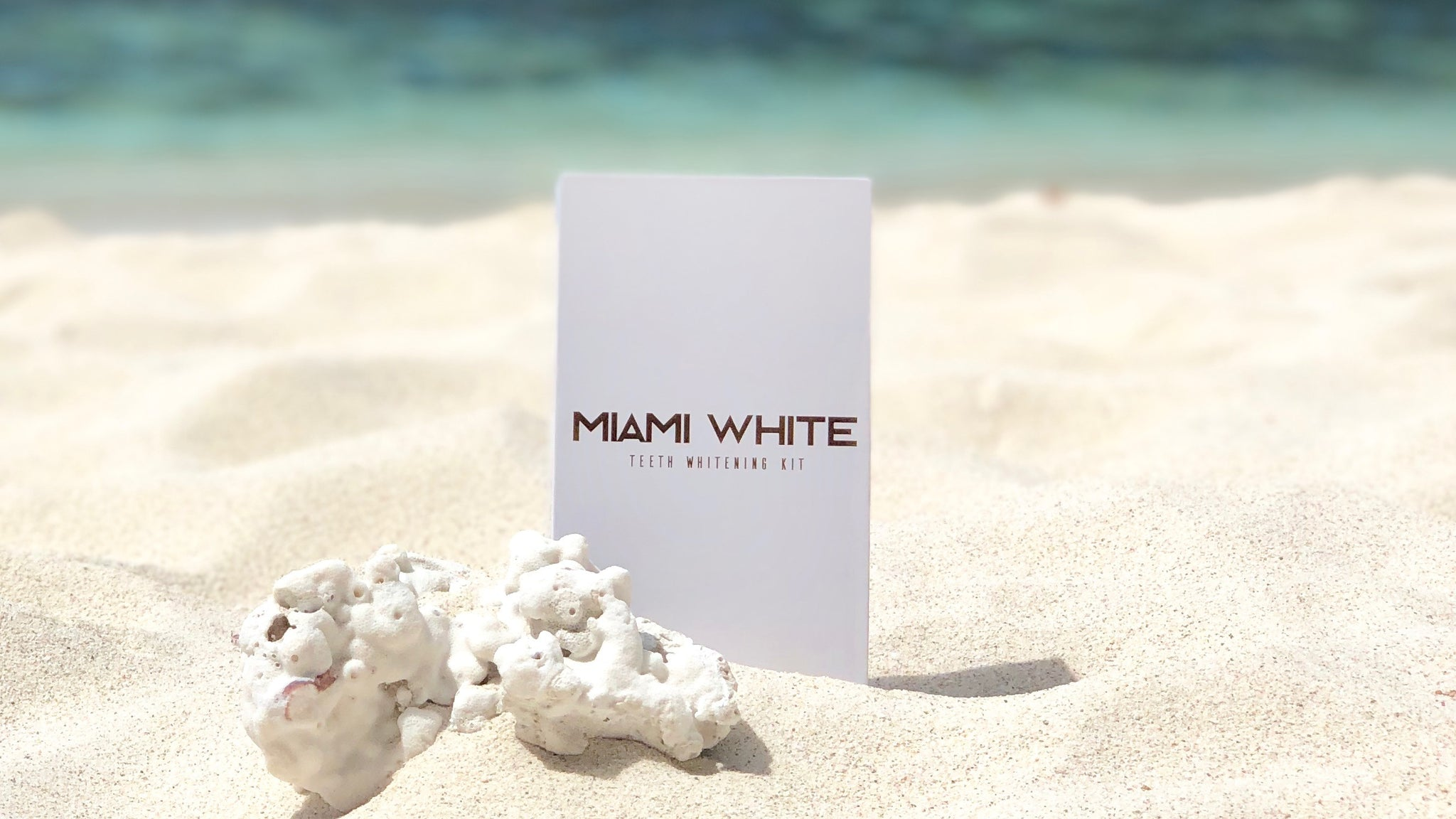 Miami white teeth whitening kit on a beach in el nido