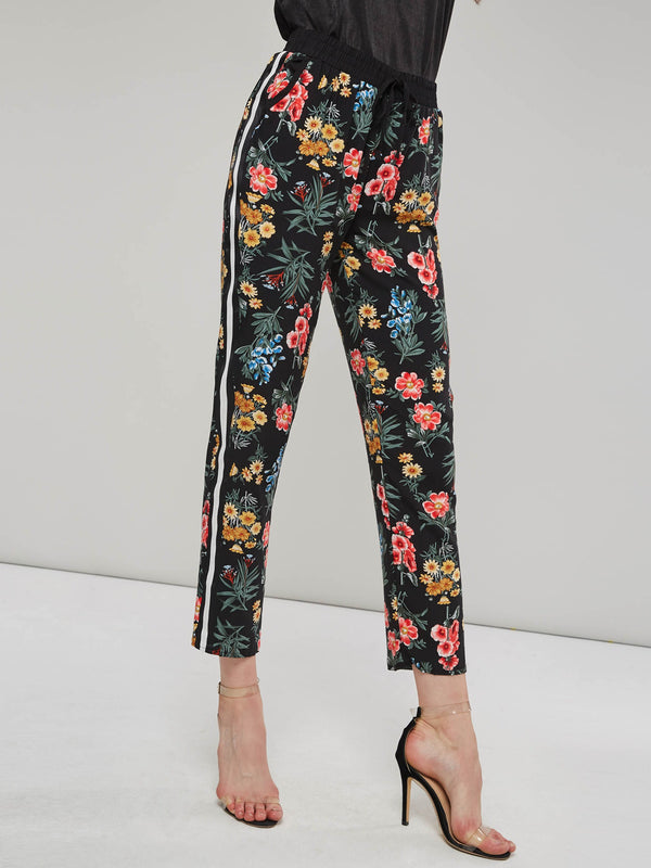 Pantaloni casual donna a righe laterali con stampa floreale di Hebedress