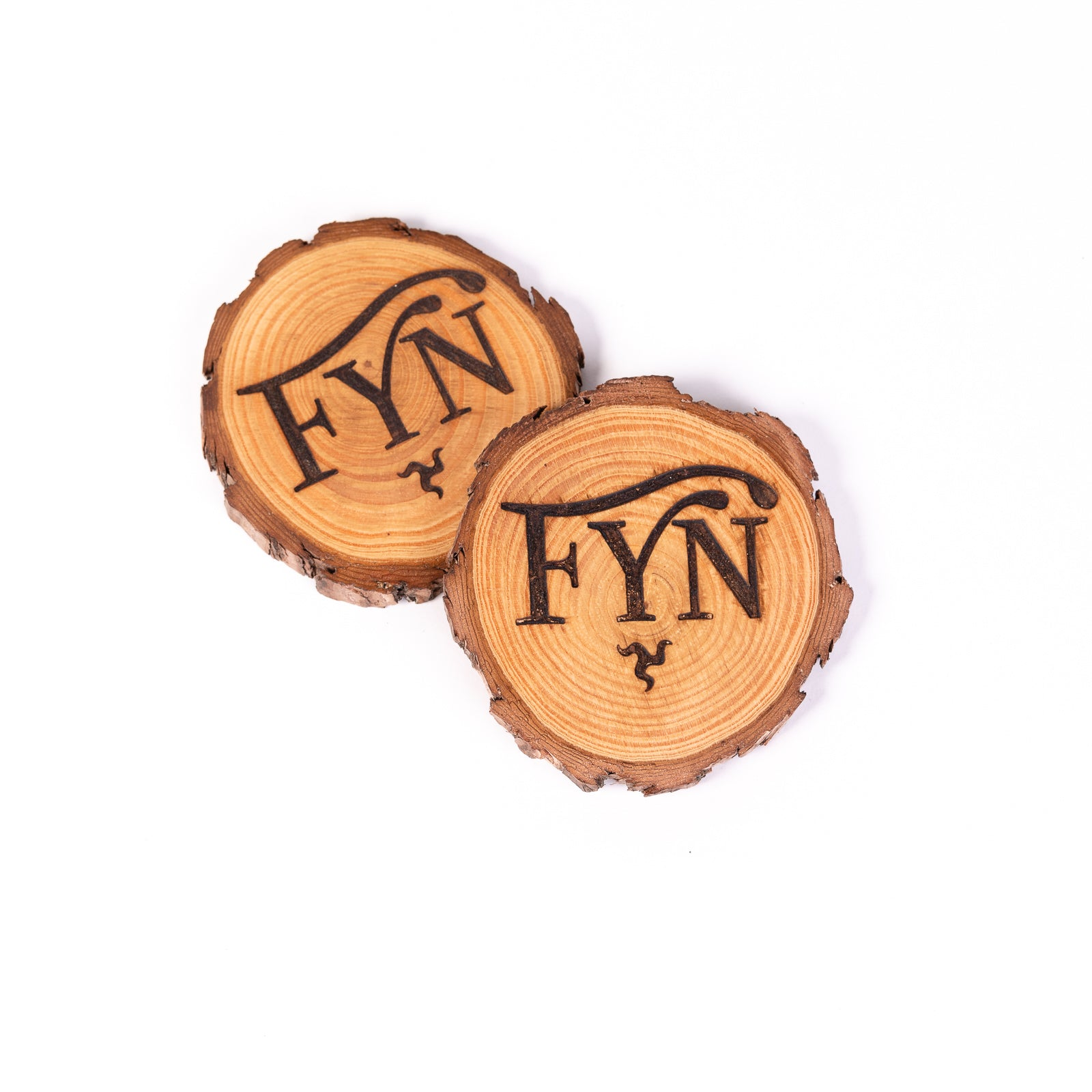 Pair of Carved Wooden Fyn Coasters