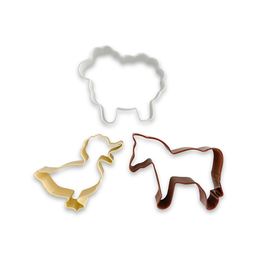 An adorable set of farm animal cutters, featuring one brown horse, one yellow duck and one white sheep