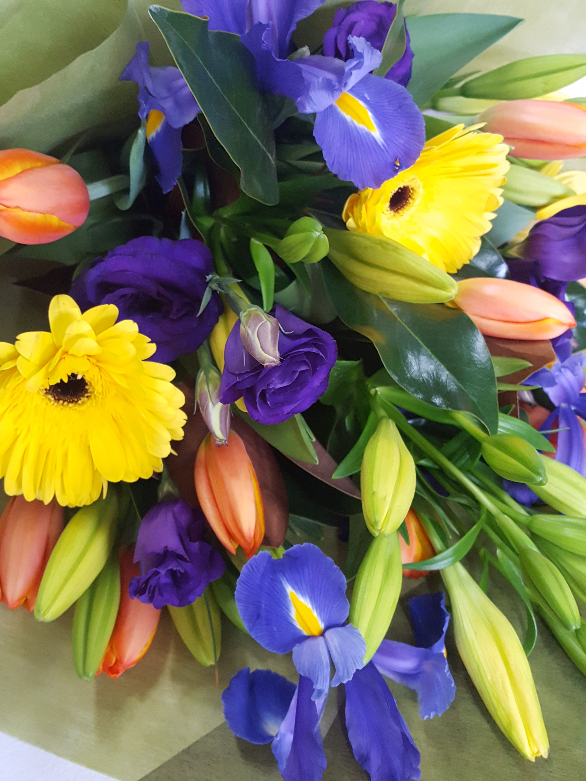 A selection of brightly coloured seasonal flowers such as iris,lilies,tulips,lisianthus & gerberas.