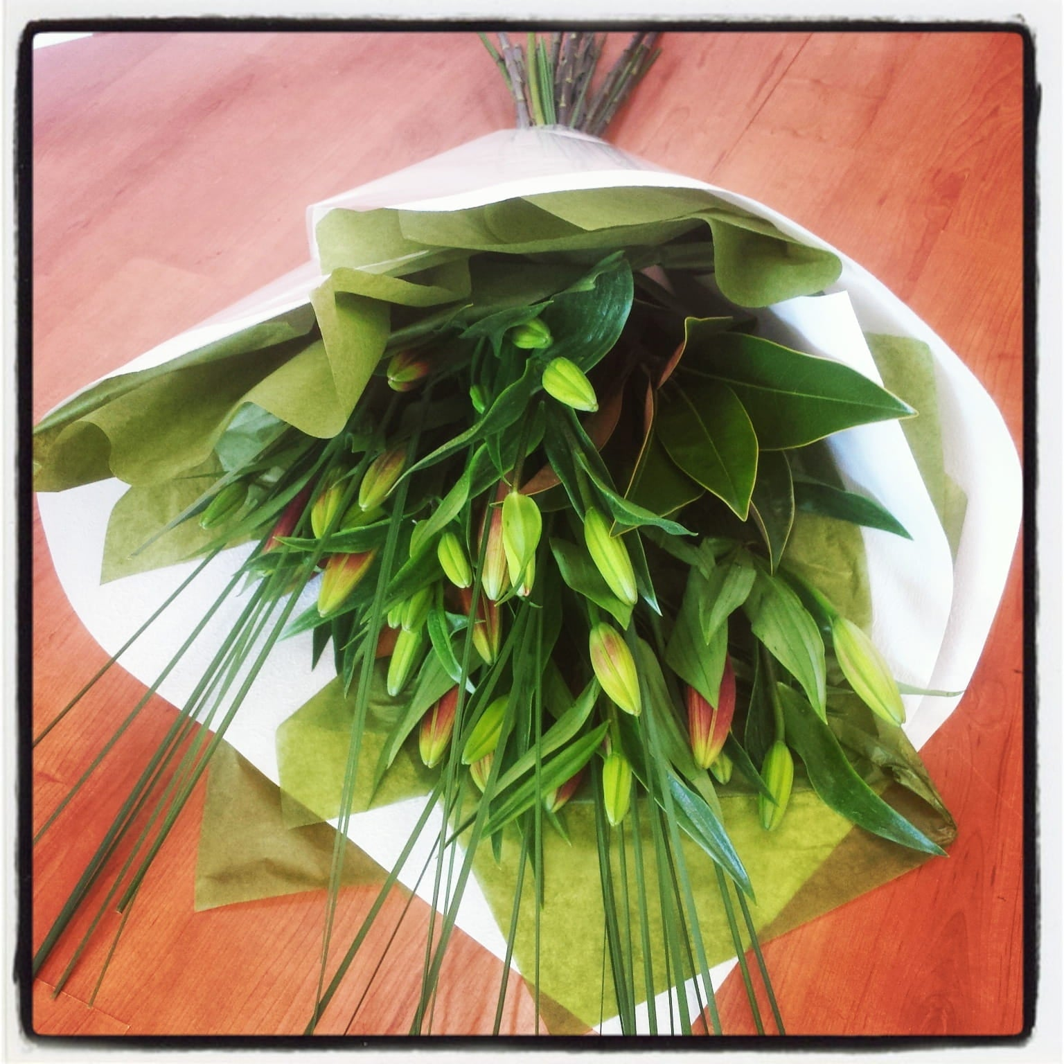 Simplicity bouquet is filled with long lasting lilies & lush foliage.