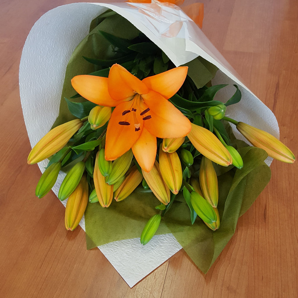 Have Virginia Mary Florist in Bendigo deliver one of their most popular designs with a bunch of wrapped lilies.