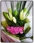 Fancy....a bunch of roses & lilies gift wrapped colours will vary but here we have pink roses & white lilies.