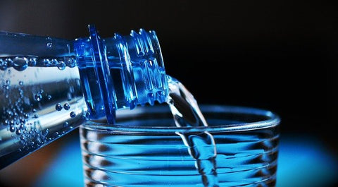 plastic water bottle and glass