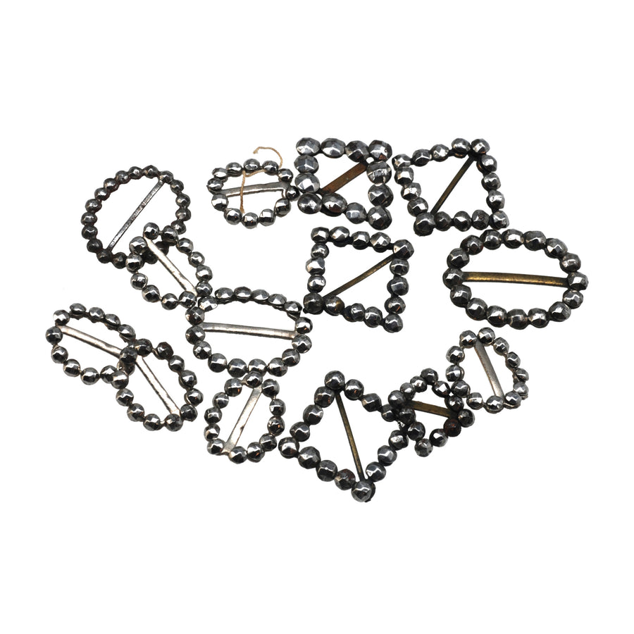 Box of Georgian Cut Steel Dolls Shoe Buckles - Front