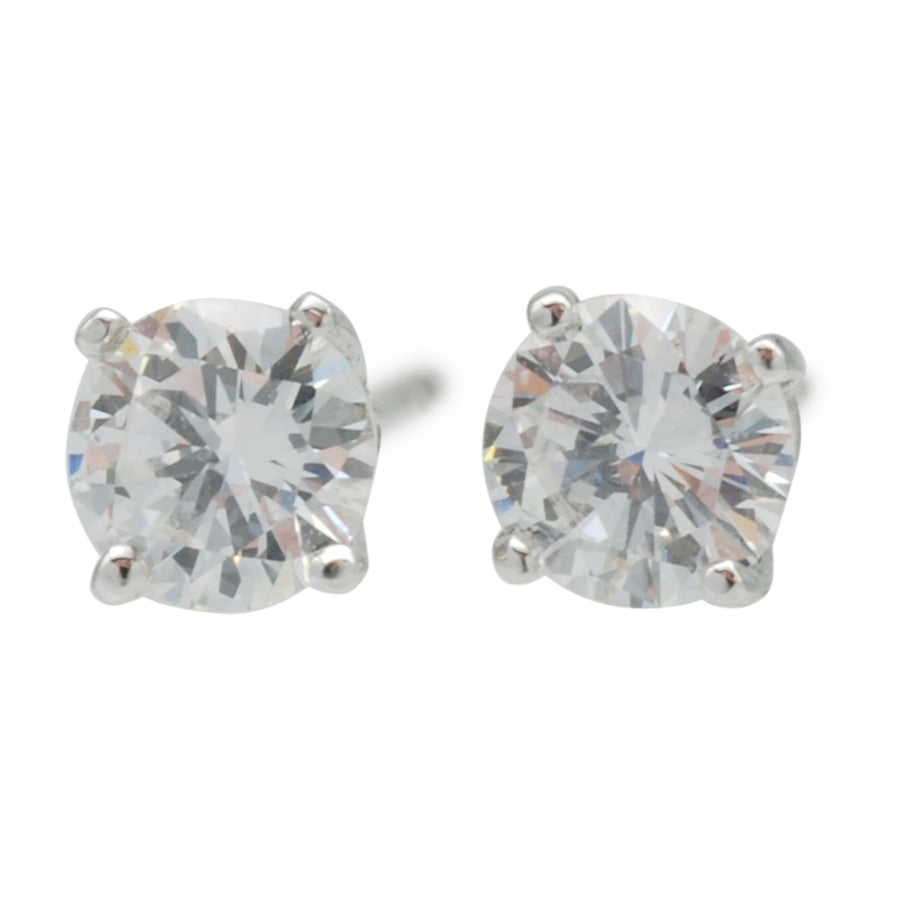 Solitaire diamond and 18ct white gold stud earrings .