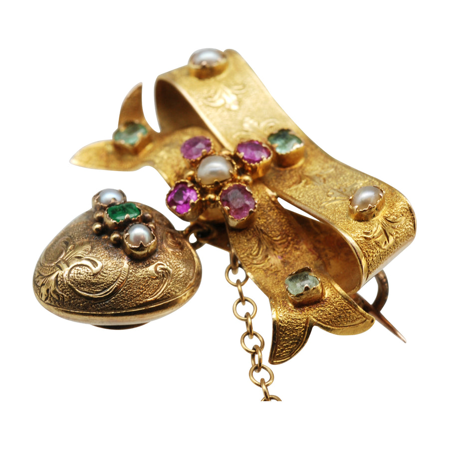 Mid Victorian 15ct gold bow and heart locket brooch set with gems