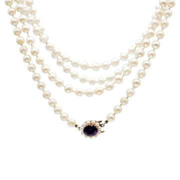 Mid century semi baroque, opera length pearl necklace with amethyst clasp.