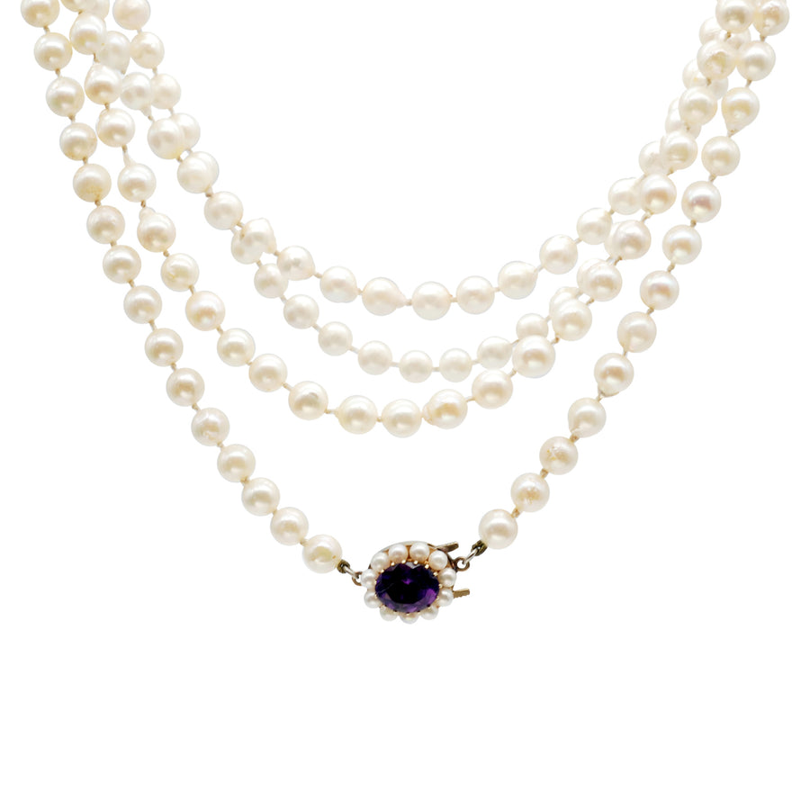 Mid century semi baroque, opera length Akoya pearl necklace with amethyst clasp.