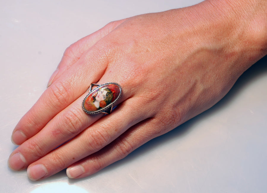 Arts and Crafts Enamel and Foil Backed Portrait Ring.