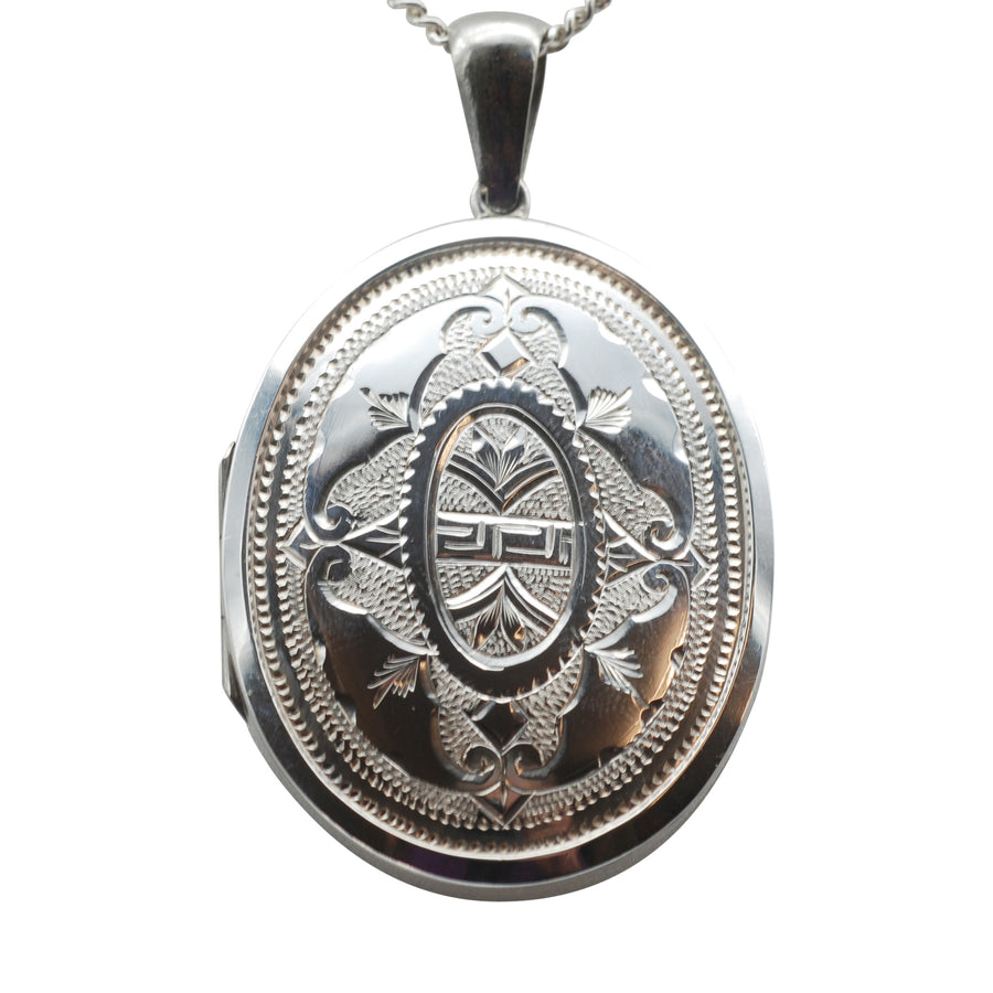 Large Engraved Oval Silver locket Circa 1900