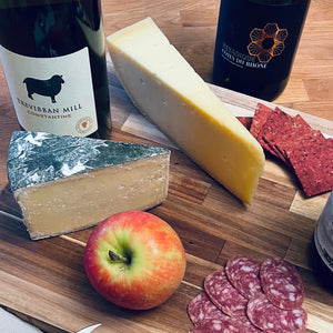 Wine and cheese selection with fruit and charcuterie