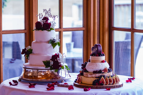 Cheese wedding cake with a traditional wedding cake