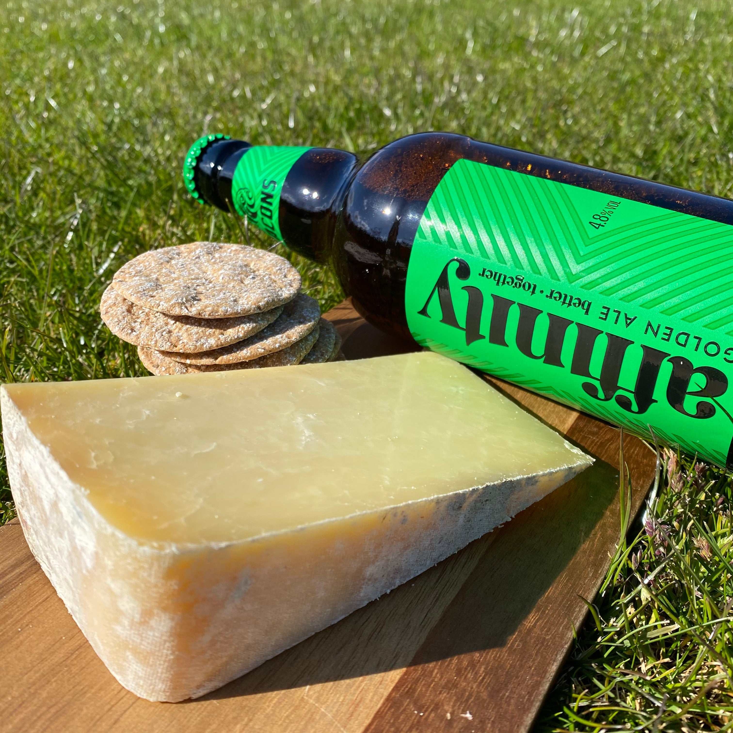 Bottle of Affinity beer, Pitchfork cheese, and crackers