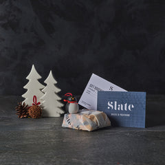 wrapped gift and voucher with festive decorations