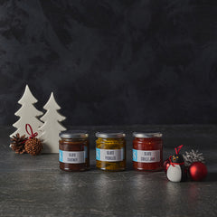 jars of chutney and pickles with festive decorations