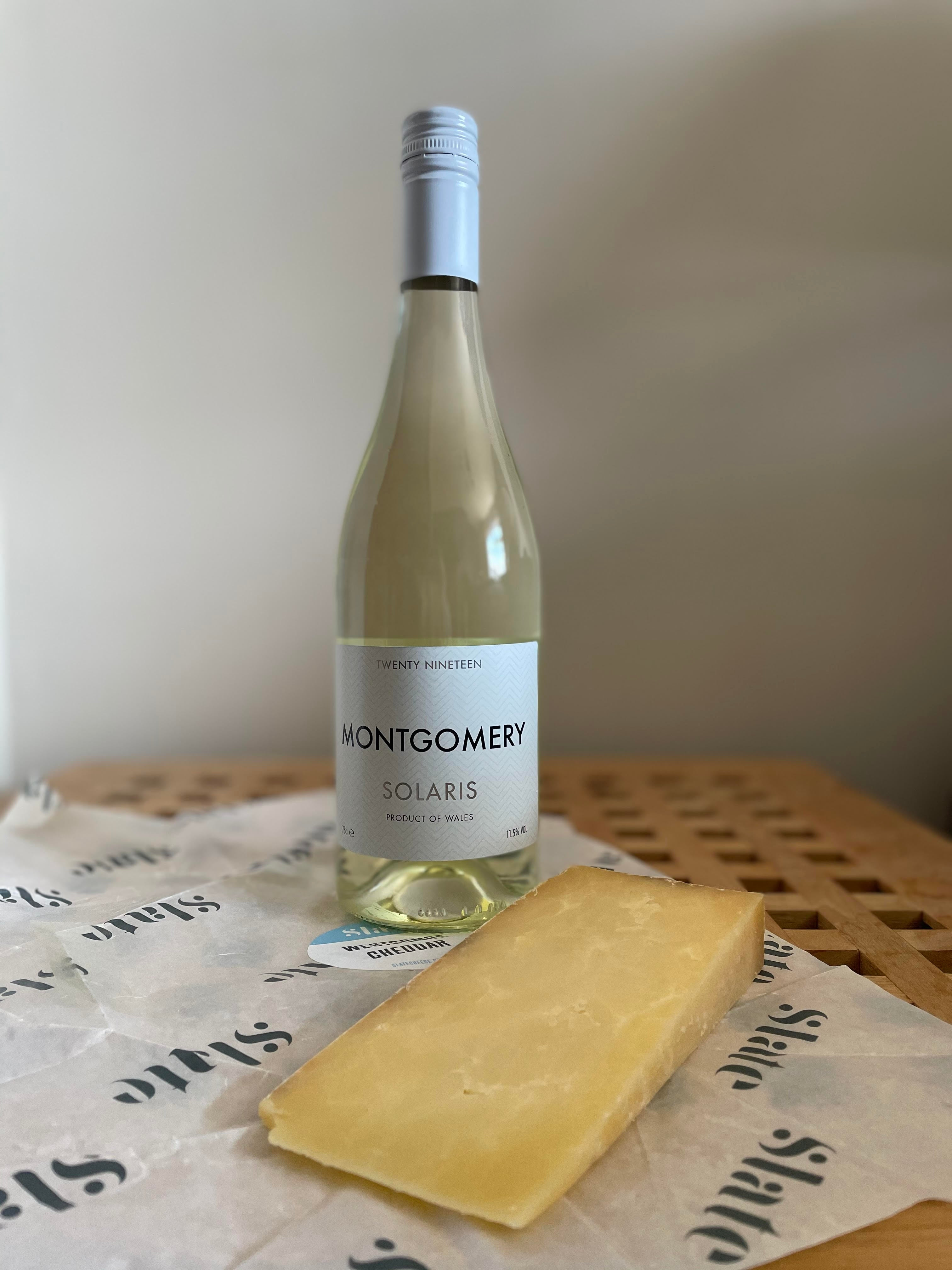 Westcombe Cheddar with a bottle of Montgomery Vineyard's Solaris 2019