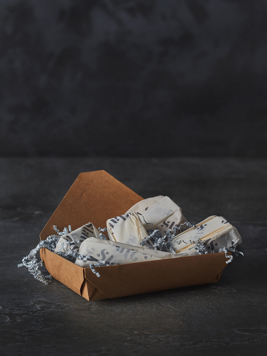 Wedding sample box of wrapped cheeses
