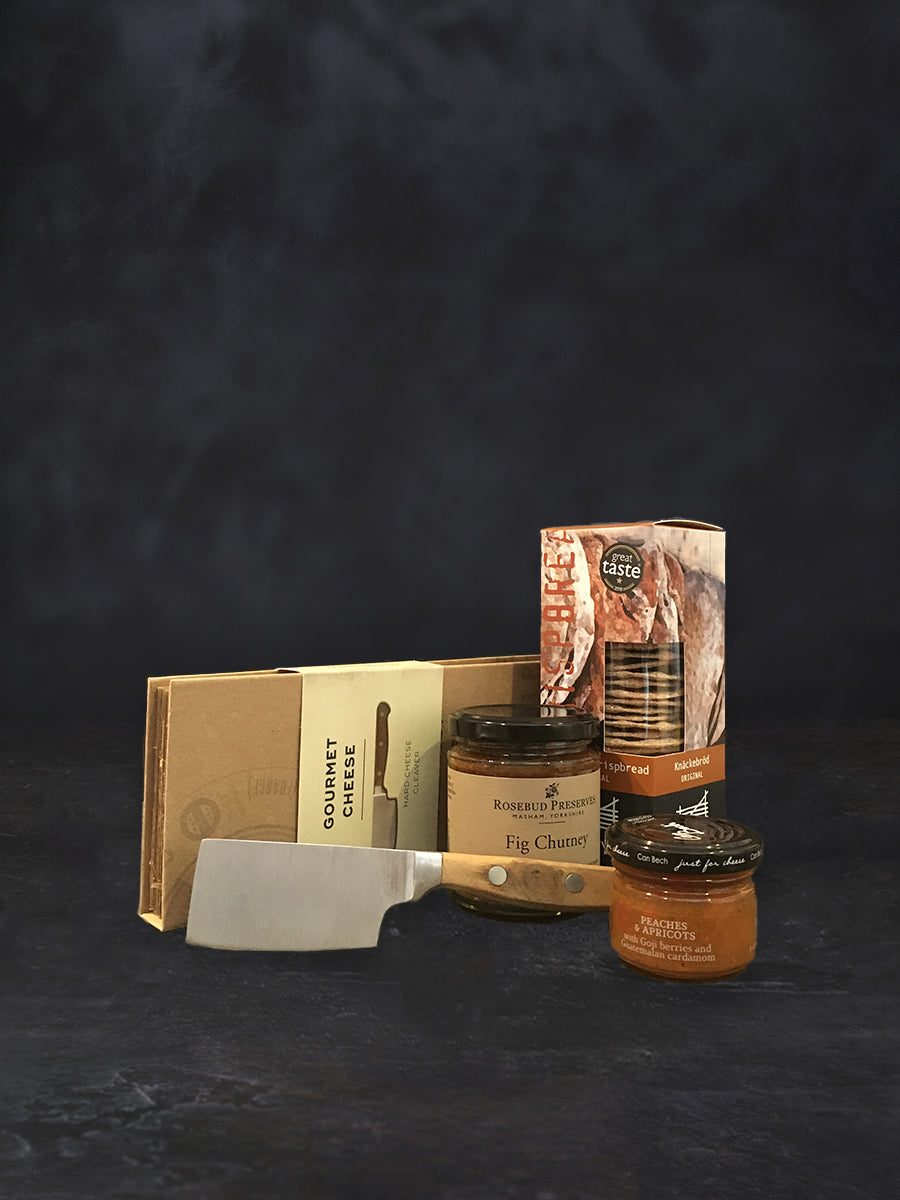 cheese cleaver, crackers, and two jars of chutney