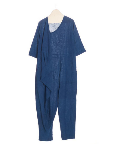 11.11 Clothing indigo jumpsuit in 100% handspun cotton. Cowl drape detail adds a twist to the classic jumpsuit.