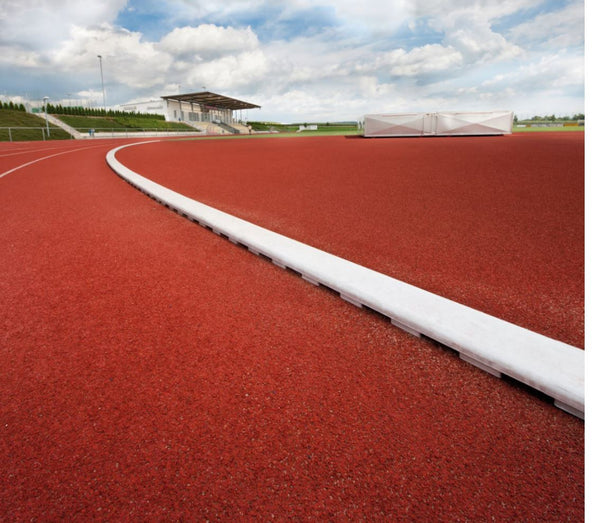 Track Curbing with Drainage