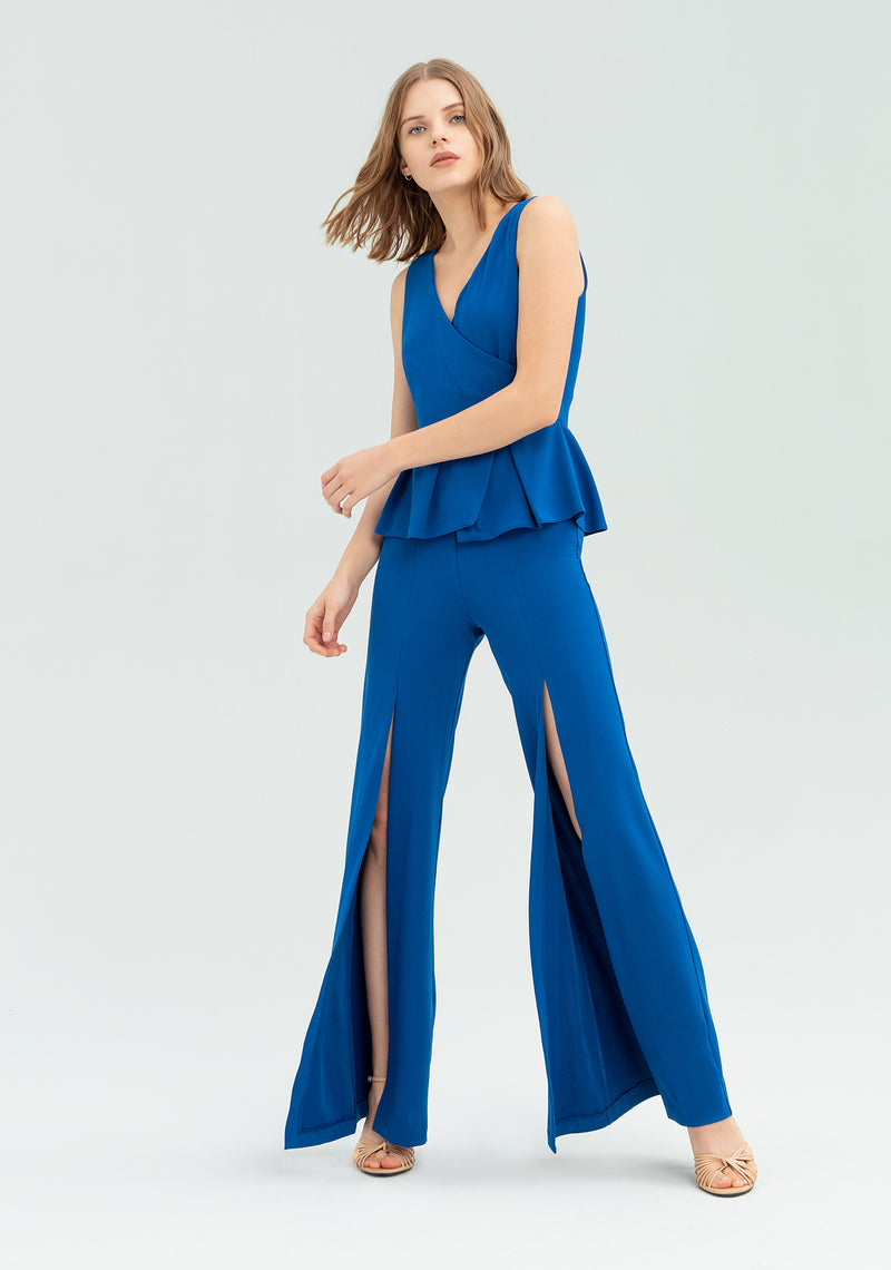 Jumpsuit con peplo e spacchi