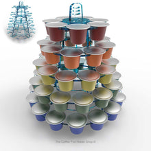 Nespresso original line coffee pod tower stand with rotating rings, shown in cool blue tint acrylic