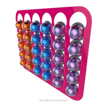Pink, wall mounted, self adhesive Nespresso Vertuo line coffee pod capsule holder. Holds 30 pods in 6 rows.