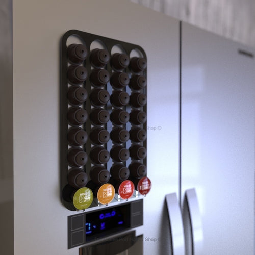 Black magnetic Dolce Gusto coffee pod capsule holder shown installed on fridge freezer.