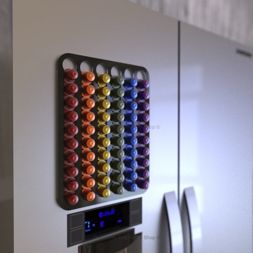Black magnetic Nespresso original line coffee pod capsule holder shown installed on fridge freezer.