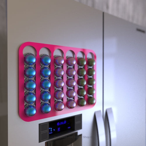 Pink magnetic Nespresso Vertuo line coffee pod capsule holder shown installed on fridge freezer.