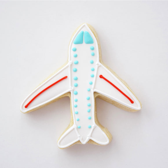 Custom decorated Airplane sugar cookie by Southern Home Bakery in Orlando, Florida.