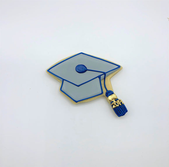 Custom decorated Graduation Cap sugar cookie by Southern Home Bakery in Orlando, Florida.