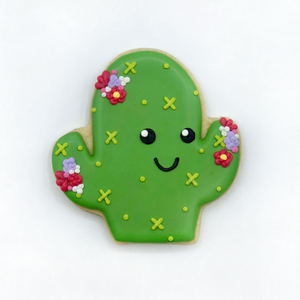 Custom decorated happy cactus sugar cookie by Southern Home Bakery in Orlando, Florida.