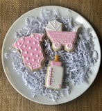 Custom decorated Pink Baby sugar cookie set by Southern Home Bakery in Orlando, Florida.