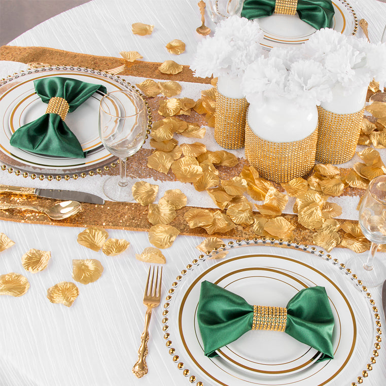 gold and emerald wedding featuring silk petals, glitz stripe, and glass beaded charger plates