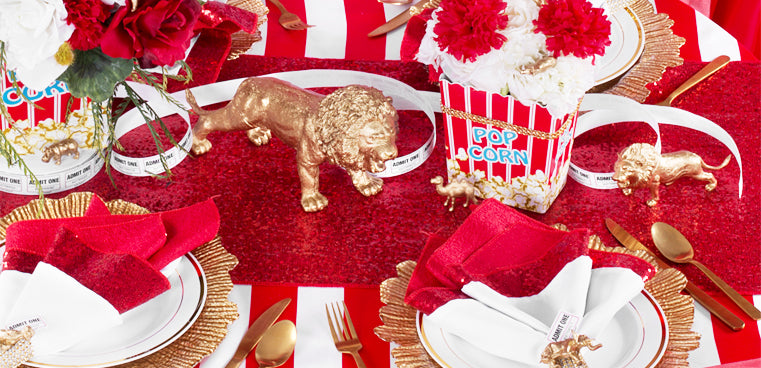 carnival themed event with red sequins and striped tablecloth